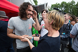© Licensed to London News Pictures . 20/06/2015 . London , UK . RUSSELL BRAND and JULIE HESMONDHALGH speaking in Parliament Square . Tens of thousands of people march from the Bank of England to Parliament , to protest economic austerity in Britain . Photo credit: Joel Goodman/LNP
