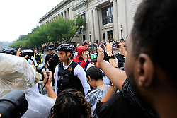 A group of people are taken into a police barricade and cover their faces after being seen carrying a flag associated with white supremacists in front of the White House and chased by protestors on Sunday, August 12, 2018. Photo by Darryl Smith/TNS/ABACAPRESS.COM
