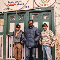 Royal Nepal Airlines official stand in front of the office at Lukla Airstrip in the Khumbu region of Nepal, one of the most dangerous in the world, where flights are commonly overbooked and delayed.