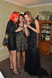 Left to right, KIM JOHNSON, AVERYL OATES and GABRIELLA PEACOCK at the Bumpkin Halloween Dinner hosted by Marissa Hermer held at Bumpkin, 119 Sydney Street, London on 23rd October 2014.
