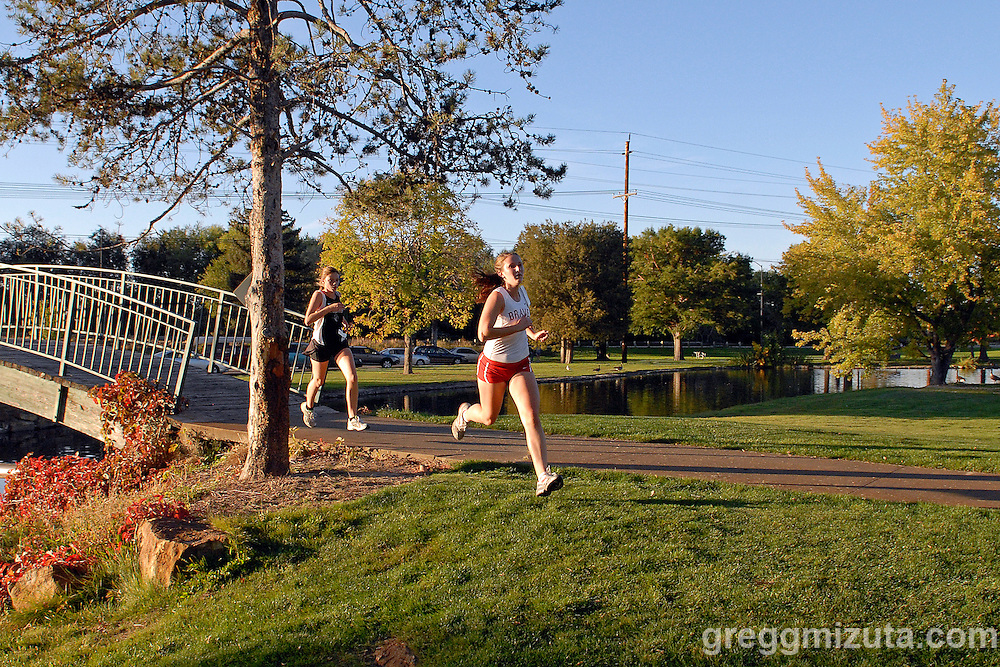 Boise junior Mary Hickerson and Capital sophomore Theresa Konecni during the Boise City Meet at Ann Morrison Park on October 14, 2010.