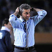 Fenerbahce's head coach Aykut Kocaman is in stress during their Turkish superleague soccer match S.B. Elazigspor between Fenerbahce at the Ataturk stadium in izmir Turkey on Saturday 18 August 2012. Photo by TURKPIX