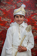 Levent after his traditional circumcision in Sariyer, a town on the Bosphorus coastline north of Istanbul. The boys dress in costumes of Ottoman sultans on the day when they are seen as stepping into manhood.