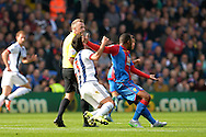 Jason Puncheon of Crystal Palace hits Claudio Yacob of West Bromwich Albion in the face during the 1st half. Barclays Premier League match, Crystal Palace v West Bromwich Albion at Selhurst Park in London on Saturday 3rd October 2015.<br /> pic by John Patrick Fletcher, Andrew Orchard sports photography.