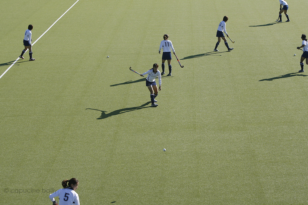 "Saturday September 16th 2007. Vaucresson (Hauts de Seine),France..The Japonese field hockey team warms up before an exhibition game against ""Le Stade Francais""."