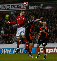 Photo: Richard Lane/Richard Lane Photography. Nottingham Forest v Blackpool. Coca Cola Championship. 13/12/2008. Keith Southern (R) is beaten in the air by Matt Thornhill (L)