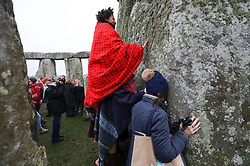 People gather at Stonehenge in Wiltshire on the winter solstice to witness the sunrise after the longest night of the year.