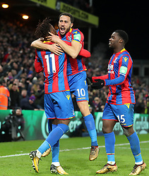 Crystal Palace's Andros Townsend (centre) celebrates scoring his side's first goal with team-mates Wilfried Zaha (left) and Jeffrey Schlupp during the Premier League match at Selhurst Park, London, Thursday 28th December 2017