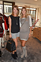 Left to right, GABRIELLA PEACOCK and MALIN JEFFERIES at a lunch hosted by Alice Naylor-Leyland and Tamara Beckwith in celebration of the Coach 2015 collection held at Coach, New Bond Street, London on 18th September 2014.