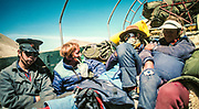 Greg Mortimer, Australian mountaineer breathing oxygen having just come down from first ascent White Limbo route (no bottled oxygen), North face Chomolungma - riding in back of truck with Howard Whelan and Mike Dillon, leaving Rongbuk with Chinese Liaison Officer, Tibet, 1984