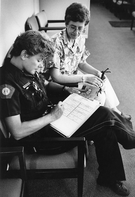 ©1990 female police officer at work in Austin, Texas.