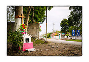 SHOT 2/21/19 5:03:41 PM - A small and brightly decorated roadside capilla on the outskirts of the small town of Panaba in the Yucatan Peninsula of Mexico. The capillas are often dedicated to certain patron saints or the memory of someone that has died at or near the site. Common throughout the backroads and secondary highways of Mexico they often contain prayer candles, pictures, personal artifacts or handwritten notes. (Photo by Marc Piscotty / © 2019)
