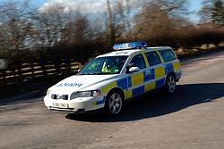 Police car speeding down road Yorkshire UK