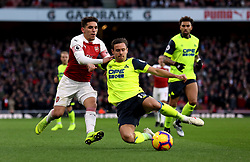 Arsenal's Lucas Torreira (left) and Huddersfield Town's Chris Lowe battle for the ball during the Premier League match at the Emirates Stadium, London.