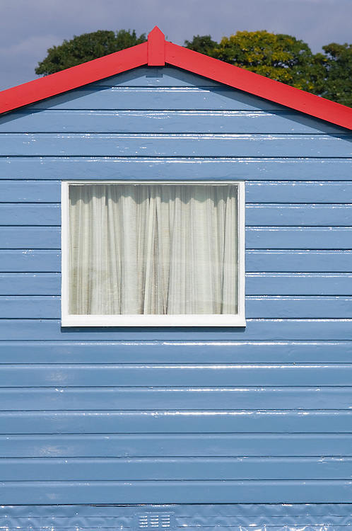 Blue wooden fisherman's hut painted window shed