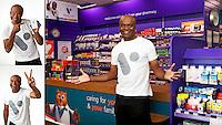 kriss akabusi smiling and holding both hands out in front of him with open palms and also another photographs showing V for victory sign in an advertising photograph for V Healthcare. Victory and peace sign