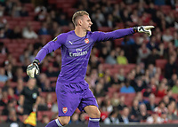 Football - 2018 / 2019 UEFA Europa League - Group E: Arsenal vs. Vorskla Poltava<br /> <br /> Bernd Leno (Arsenal FC) finds something to occupy him during a quiet first half as he points forward to his team at The Emirates.<br /> <br /> COLORSPORT/DANIEL BEARHAM