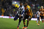 WBA's Stephane Sessegnon holds off Hull's Maynor Figueroa. Barclays Premier league, West Bromwich Albion v Hull city at the Hawthorns in West Bromwich, England on Saturday 21st Dec 2013. pic by Andrew Orchard, Andrew Orchard sports photography.