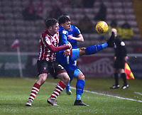 Lincoln City's Shay McCartan battles with Morecambe's Josef Yarney<br /> <br /> Photographer Andrew Vaughan/CameraSport<br /> <br /> The EFL Sky Bet League Two - Saturday 15th December 2018 - Lincoln City v Morecambe - Sincil Bank - Lincoln<br /> <br /> World Copyright © 2018 CameraSport. All rights reserved. 43 Linden Ave. Countesthorpe. Leicester. England. LE8 5PG - Tel: +44 (0) 116 277 4147 - admin@camerasport.com - www.camerasport.com