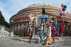 © London News Pictures. 17/09/2013 . London, UK.   Performers from Cirque Du Soleil pose outside The Royal Albert Hall in London during a photo call for their production 'Quidam' which is due to run from July 4th 2014.. Photo credit : Ben Cawthra/LNP