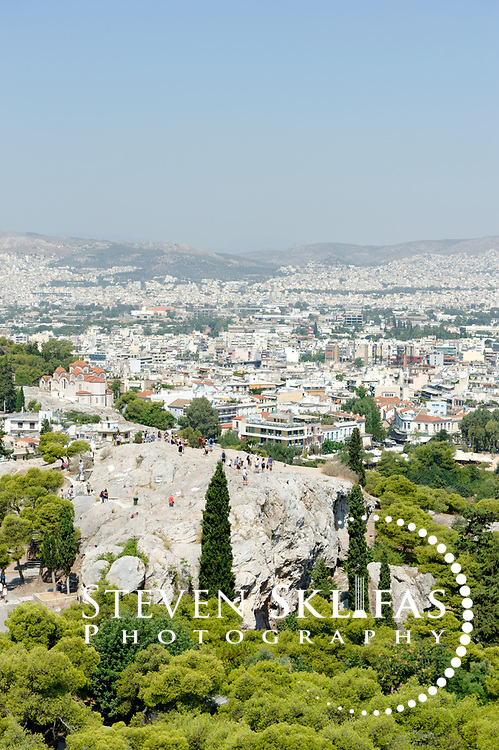 Pnyx Hill. Athens. Greece. View from the Acropolis of Aeropagos Hill, location of the first law court and the seat of the first aristocratic assembly of ancient Athens. Saint Paul preached here in 51 AD and converted and baptized the senator court judge who was to become St Dionysius the Areopagite.