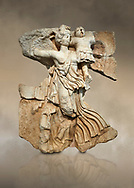 Roman Sebasteion relief  sculpture of the goddess Victory, Aphrodisias Museum, Aphrodisias, Turkey.  Against an art background.<br /> <br /> A winged goddess Victory( Nike) flies past carrying a military trophy. She wears a long light dress and has one breast and one leg exposed. Her clothing is set in motion by her swift flight. .<br /> <br /> If you prefer to buy from our ALAMY STOCK LIBRARY page at https://www.alamy.com/portfolio/paul-williams-funkystock/greco-roman-sculptures.html . Type -    Aphrodisias     - into LOWER SEARCH WITHIN GALLERY box - Refine search by adding a subject, place, background colour, museum etc.<br /> <br /> Visit our ROMAN WORLD PHOTO COLLECTIONS for more photos to download or buy as wall art prints https://funkystock.photoshelter.com/gallery-collection/The-Romans-Art-Artefacts-Antiquities-Historic-Sites-Pictures-Images/C0000r2uLJJo9_s0