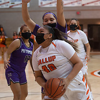 Gallup Bengal Hailey Long (40) drives to the basket as Miyamura Patriots Destiny Bryan (23) defends during their varsity basketball game at Gallup High School in Gallup Friday.