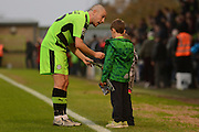 Forest Green Rovers midfielder Liam Noble (15) signs autographs for two young fans during the Vanarama National League match between Forest Green Rovers and Dagenham and Redbridge at the New Lawn, Forest Green, United Kingdom on 29 October 2016. Photo by Alan Franklin.