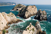 Top view of sea stacks in Maruata Bay, Michoacan State, Mexico. Maruata is a Pomaro fishing village set in a beautiful bay and a popular destination among independent-minded travelers.
