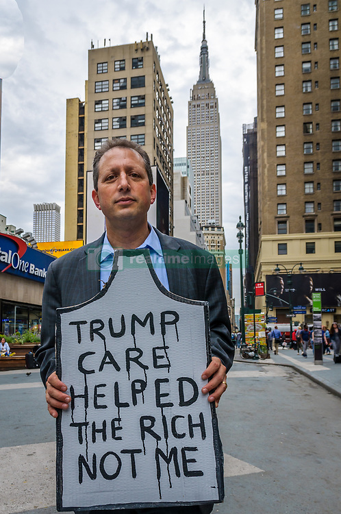 """June 4, 2017 - New York, New York, United States - Councilmember and co-founder of #GetOrganizedBK Brad Lander - Health providers, patients, grassroots organizers, NYC Councilmember and co-founder of #GetOrganizedBK Brad Lander, NY assemblymember Richard Gottfried and concerned New York residents organized a Die-In against Trumpcare and for affordable coverage for all on June 4, 2017; at 33 Street Plaza, W. 33 St. between 7the and 8th Aves, Manhattan. Protestors rally to warn US Senate of human toll of """"repeal/replace"""" health plans. (Credit Image: © Erik Mcgregor/Pacific Press via ZUMA Wire)"""
