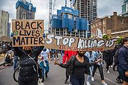 Following the death of George Floyd while in the custody of police in Minneapolis, demonstrations of solidarity have started all over the world as people gather to protest against institutional racism and in support of the Black Lives Matter movement, as seen here with thousands of people gathering to walk to central London from Vauxhall on 7th June 2020 in London, England, United Kingdom. Black Lives Matter is an international human rights movement, originating in the African-American community, that campaigns against violence and systemic racism towards black people. (photo by Barry Lewis/In Pictures via Getty Images)