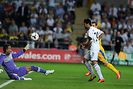 Swansea city's Alejandro Pozuelo (24) scores his sides 5th goal. UEFA Europa league, play off round, 1st leg match, Swansea city v FC Petrolul Ploiesti at the Liberty stadium in Swansea on Thursday 22nd August 2013. pic by Andrew Orchard , Andrew Orchard sports photography,