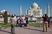 Tourists taking photographs at The Taj Mahal mausoleum southern view Uttar Pradesh, India