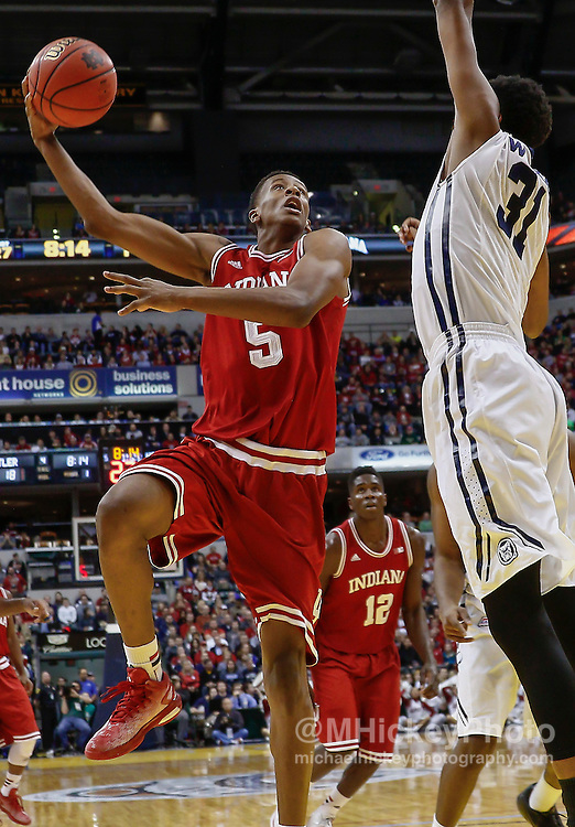 INDIANAPOLIS, IN - DECEMBER  20: Troy Williams #5 of the Indiana Hoosiers shoots the ball against Kameron Woods #31 of the Butler Bulldogs at Bankers Life Fieldhouse on December 20, 2014 in Indianapolis, Indiana. Indiana defeated Butler 82-73. (Photo by Michael Hickey/Getty Images) *** Local Caption *** Troy Williams; Kameron Woods