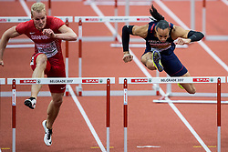 Andreas Martinsen of Denmark and Pascal Martinot-Lagarde of France  compete in the 60m Hurdles Men Heats on day one of the 2017 European Athletics Indoor Championships at the Kombank Arena on March 3, 2017 in Belgrade, Serbia. Photo by Vid Ponikvar / Sportida