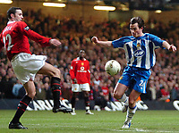 Photo: Ed Godden.<br />Manchester United v Wigan Athletic. The Carling Cup Final. 26/02/2006. Leighton Baines (R) makes his way past Man Utd's Jon O'Shea.