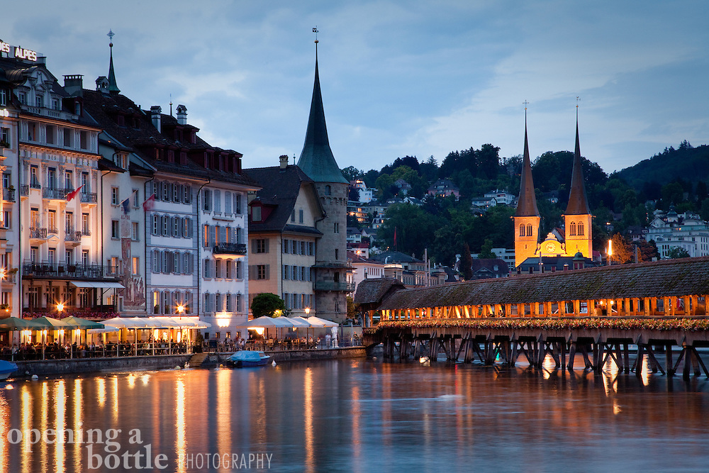 Church of St. Leodegar, the Chapel Bridge, Reuss River, and the Rathausquai of Lucerne, Switzerland.