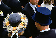 Racegoers in traditional hats  at Epsom Racecourse on Derby Day, UK