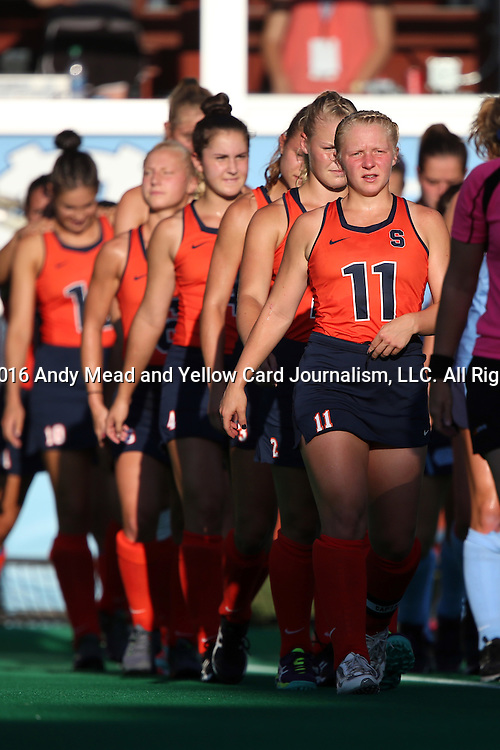23 September 2016: Syracuse's Serra Degnan (11) leads her teammates onto the field. The University of North Carolina Tar Heels hosted the Syracuse University Orange at Francis E. Henry Stadium in Chapel Hill, North Carolina in a 2016 NCAA Division I Field Hockey match. UNC won the game 3-2 in two overtimes.