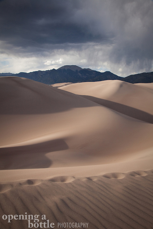 Foot steps cross the dune field of Great Sand Dunes National Park, Colorado.