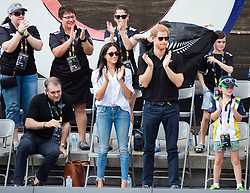 Prince Harry, second right and his girlfriend Meghan Markle, centre, cheer while watching the wheelchair tennis competition at the Invictus Games in Toronto, ON, Canada, Monday September 25, 2017. This is Prince Harry's first public appearance with Markle. Photo by Nathan Denette/CP/ABACAPRESS.COM