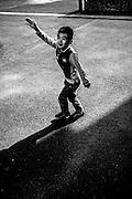 April 2015. Paris. Kid plays on La villette's park.