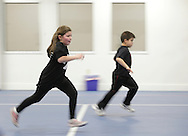 Monroe, New York - Children run across the gym while playing a game at the new South Orange Family YMCA on Wednesday, Feb. 16, 2011.