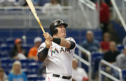 May 31, 2017 - Miami, FL, USA - The Miami Marlins' Justin Bour hits his second home run of the game, a two-run shot in the sixth inning against the Philadelphia Phillies on Wednesday, May 31, 2017 at Marlins Park in Little Havana in Miami. The Marlins won, 10-2. (Credit Image: © Pedro Portal/TNS via ZUMA Wire)