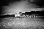 Eilean Donan offers one of the most iconic images of Scotland. It is situated on an island at the point where three great sea lochs meet, and surrounded by some majestic scenery.<br /> <br /> First inhabited around the 6th century, the first fortified castle was built in the mid 13th century and stood guard over the lands of Kintail. Since then, at least four different versions of the castle have been built and re-built as the feudal history of Scotland unfolded through the centuries.<br /> <br /> Partially destroyed in a Jacobite uprising in 1719, Eilean Donan lay in ruins for the best part of 200 years until Lieutenant Colonel John MacRae-Gilstrap bought the island in 1911 and proceeded to restore the castle to its former glory. After 20 years of toil and labour the castle was re-opened in 1932.<br /> <br /> This photograph is a wet plate version of the view of Eilean Donan Castle from the south  on Loch Duich through to Loch Alsh. The photograph can be purchased as print, mounted print in frames, canvas or aluminum or as a digital file.