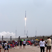 """Spectators line Playalinda Beach as NASA's Maven, short for Mars Atmosphere and Volatile Evolution, with a capital """"N'' in EvolutioN, atop a United Launch Alliance Atlas 5 rocket, lifts off from Cape Canaveral Air Force Station, Monday, Nov. 18, 2013, in Cape Canaveral, Fla. (AP Photo/Alex Menendez)"""