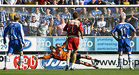 Photo: Paul Thomas.<br /> Wigan Athletic v Portsmouth. The Barclays Premiership. 29/04/2006.<br /> <br /> Portsmouth's Matthew Taylor (out of picture right) score's a penalty goal past Wigan goalkeeper Mike Pollitt.
