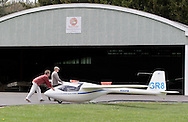 Wurtsboro, NY - Two men push a D W L K K B1-PW-5 glider at the grand reopening of Wurtsboro Airport on May 11, 2008.