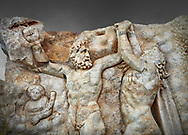 Close up of a Roman Sebasteion relief sculpture of Zeus and Prometheus, Aphrodisias Museum, Aphrodisias, Turkey.  Against a grey background. <br /> <br /> Prometheus is screaming in pain. Zeus had given him a terrible punishment for giving fire to man: he was tied to the Caucasus mountains and had his liver picked out daily by an eagle. Herakles shot the eagle and is undoing the first manacle. He wears his trade mark lion-skin and thrown his club to one side. A small mountain nymph, holding a throwing stick appears amongst the rocks. .<br /> <br /> If you prefer to buy from our ALAMY STOCK LIBRARY page at https://www.alamy.com/portfolio/paul-williams-funkystock/greco-roman-sculptures.html . Type -    Aphrodisias     - into LOWER SEARCH WITHIN GALLERY box - Refine search by adding a subject, place, background colour, museum etc.<br /> <br /> Visit our ROMAN WORLD PHOTO COLLECTIONS for more photos to download or buy as wall art prints https://funkystock.photoshelter.com/gallery-collection/The-Romans-Art-Artefacts-Antiquities-Historic-Sites-Pictures-Images/C0000r2uLJJo9_s0