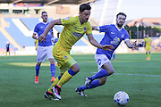 AFC Wimbledon midfielder Chris Whelpdale (11) and Peterborough United defender Andrew Hughes (3) during the EFL Cup match between Peterborough United and AFC Wimbledon at ABAX Stadium, Peterborough, England on 9 August 2016. Photo by Stuart Butcher.